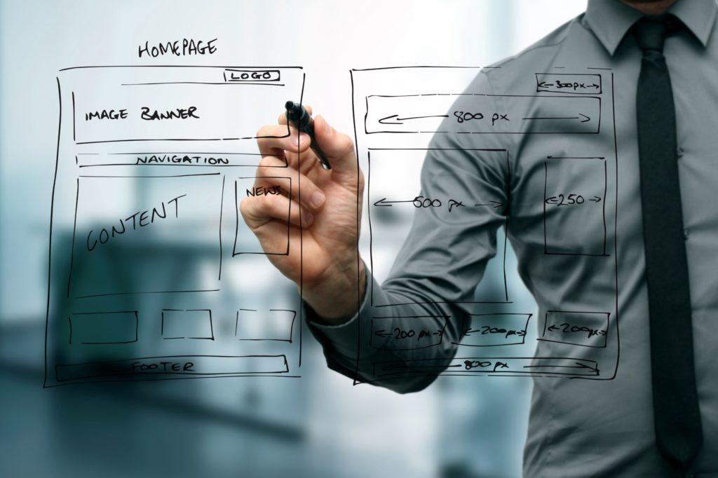 Designer Drawing Website Wireframe
